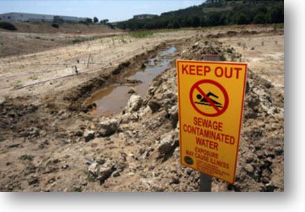 sewage spill w sign