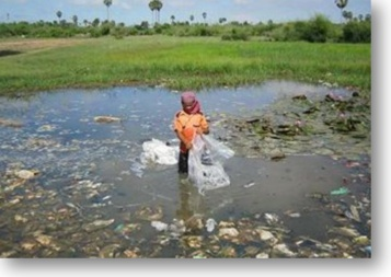 Young Boy in Polluted Water