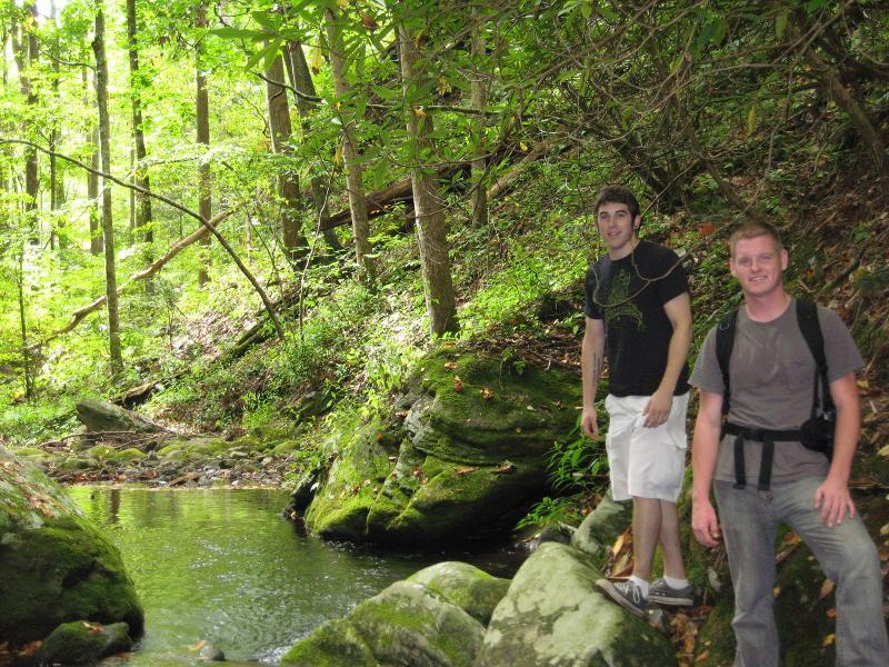 Ben and Ryan hiking near water