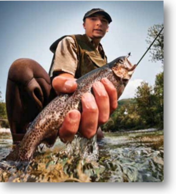 Man holding a trout