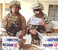 Marines in Iraq opening Care Packages