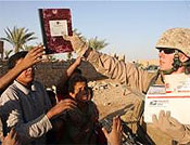 RCT 5 Marines give school supplies to Iraqi children