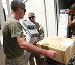 Marine getting care packages in Iraq