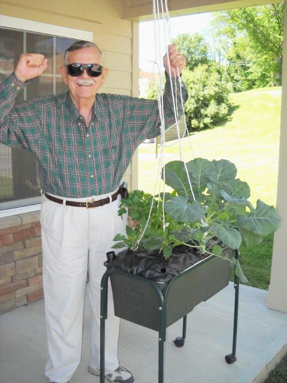 A man from Bristol_ VA with his flourishing Garden Box from HFFF