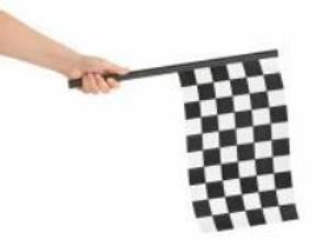 Checkered flag in hand isolated on white background
