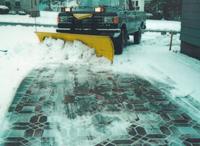 snow plow on paver driveway