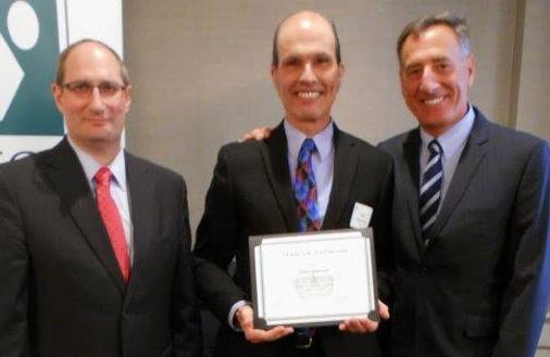 Paul Donovan receives award