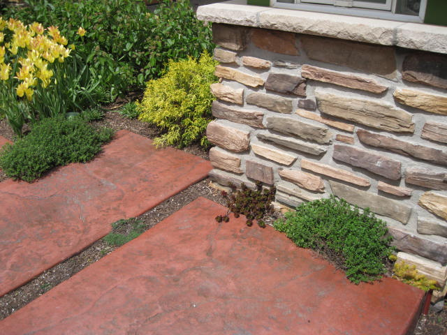 Stamped colored concrete by Heidi's Lifestyle Gardens