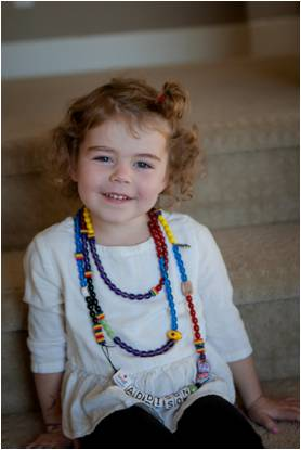 Addison Willis wearing her Beads of Courage necklace