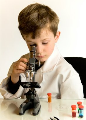 Young Boy Looking into Microscope