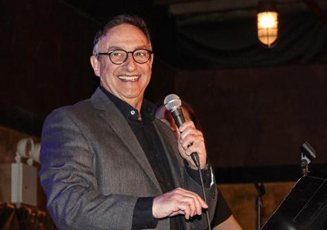 Ira Flatow holding mic