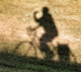 shadow of bicycle rider
