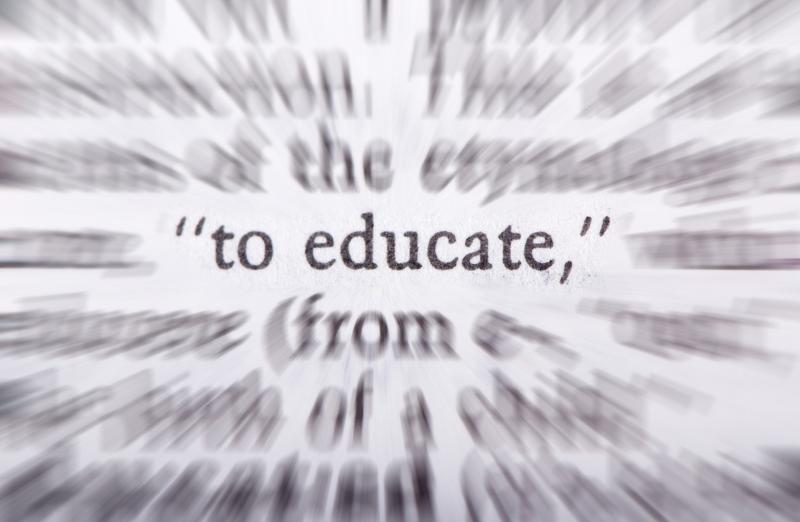 word 'educate' displayed in digitized text