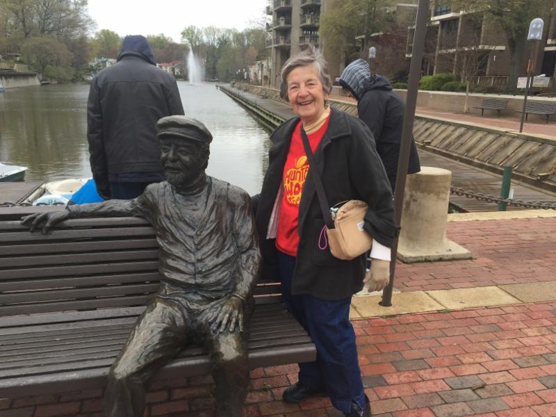 Lois Male with statue of Robert E. Simon_ the founder of Reston
