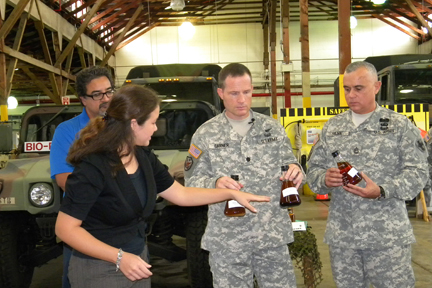Jenna Long explains biodiesel process to Army personnel