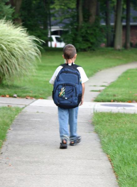 Kid on sidewalk