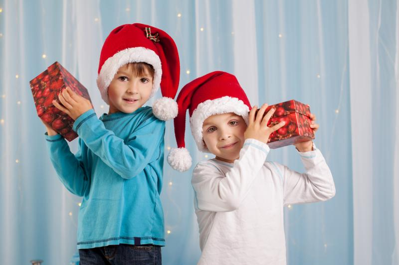 Adorable children boy brothers playing with christmas decoration. Christmas concept
