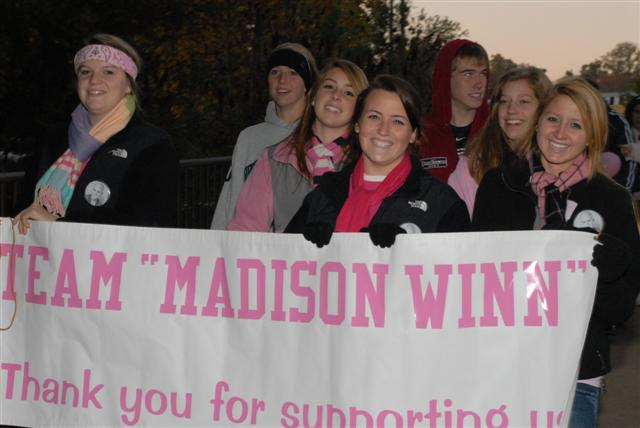 Team Madison with banner