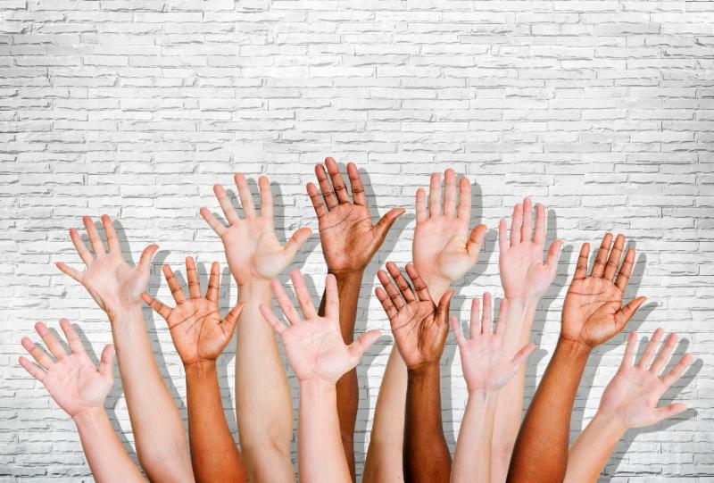 photo of diverse hands rasied