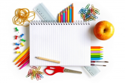 photo of school spiral notebook and school supplies