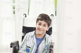 Hispanic young boy in a wheelchair