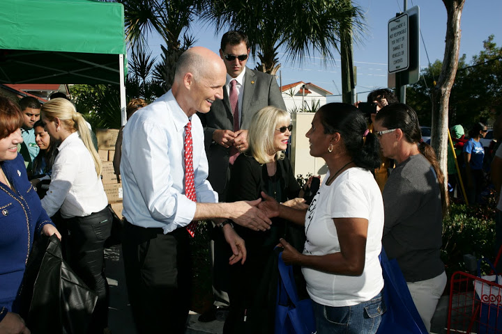 Governor and Mrs. Scott at the CAMACOL Holiday Distribution Drive