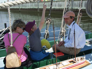 Matt Witten engages visitors aboard Lois McClure