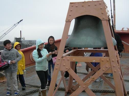 Kids ringing bell
