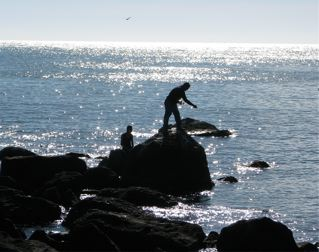 Chacala, Mexico, man and boy fishing from rocks