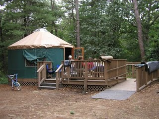 Yurt with deck and wheelchair access ramp.