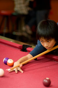 kid playing pool at irving rec center