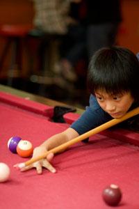 kid playing pool at irving rec center