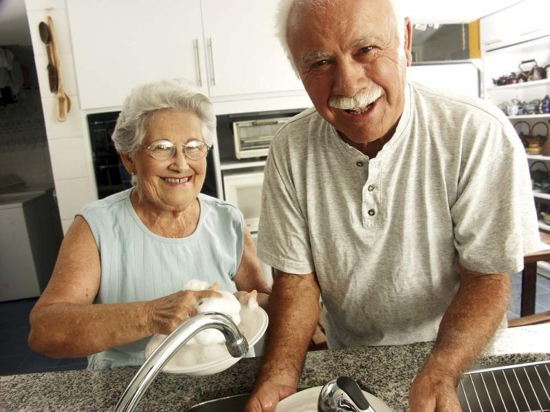 Older couple doing dishes