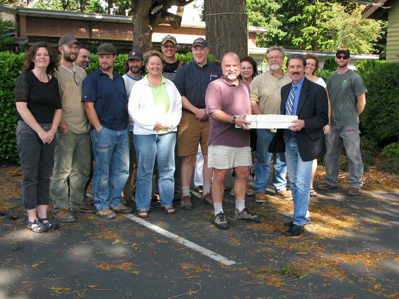 Pete Kremen delivers pizza to A-1 Builders