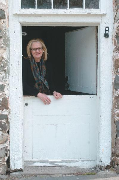 President and Descendant Mary Etta Schneider in Bevier-Elting House Door