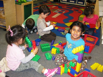 Room E Plays with Blocks