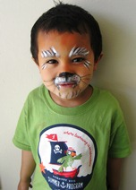 Tiger gets painted as a tiger at face painting