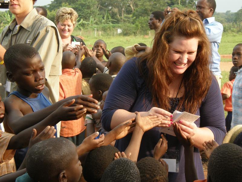 Sheri Stockwell joyfully shares Gospel tracts with Ugandan children