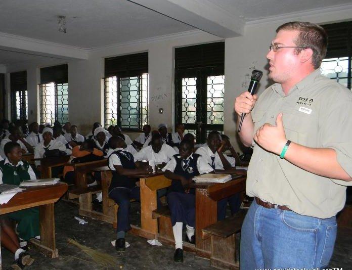 Steve Stockwell speaking at a school, Uganda