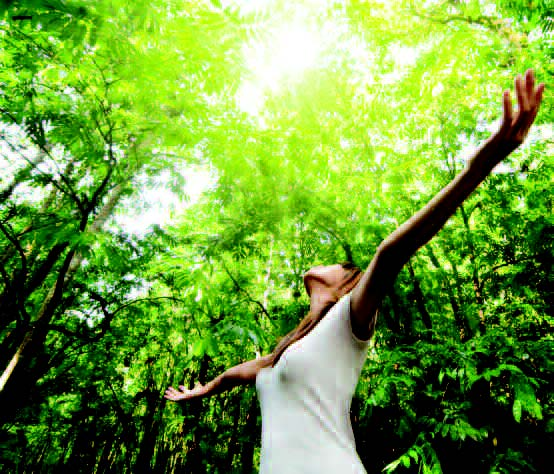 Woman open arms to sun