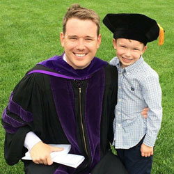 Bryan Feldhaus and his son, Owen, after the graduation ceremony.