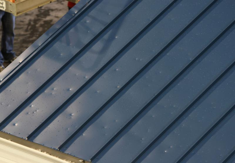 Image of hail damage on a metal roof.