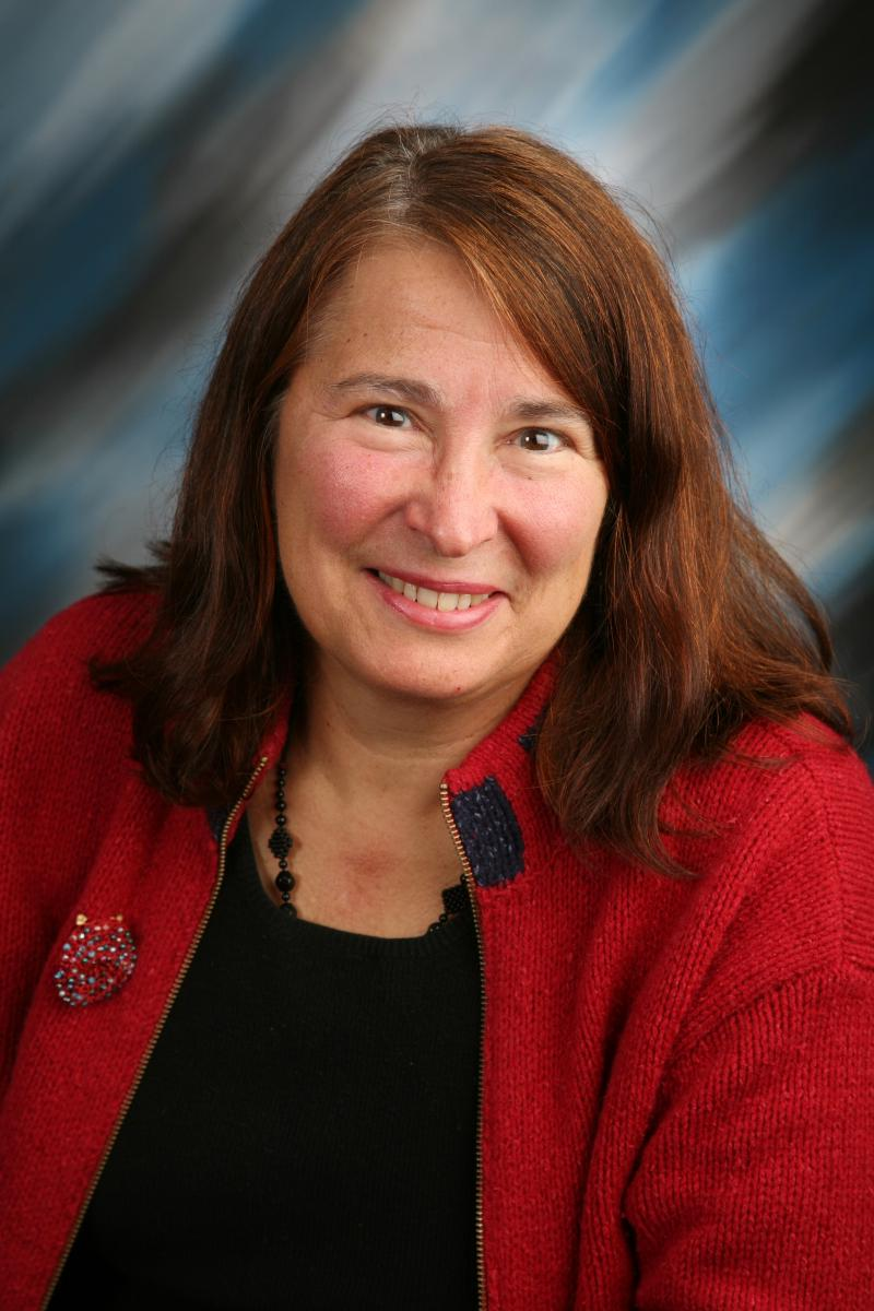 Nancy Emerson Lombardo red headshot