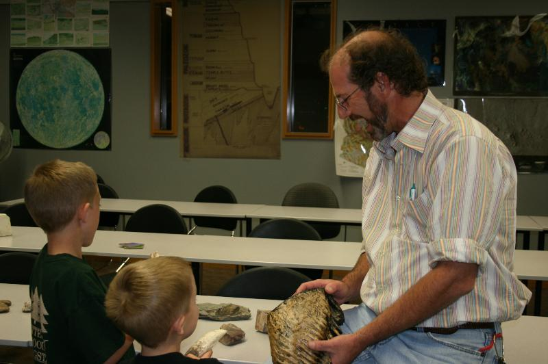 CCC Instructor Pete Koehler Shows off Dinosaur Bones