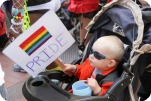 Infant with Rainbow Pride Sign