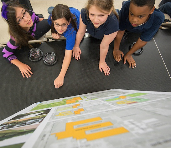 Students of Parker Elementary looking at the new plans.