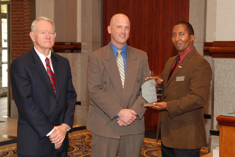 U.S. Attorney General Middle District of Alabama George Beck, Sgt. James Harry, and Central Alabama Crimestoppers Community Development Director Tony Garrett.
