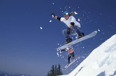 two-jumping-snowboarders.jpg