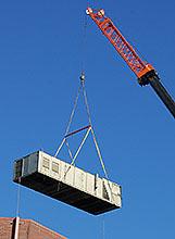 Old HVAC Unit Removal via Crane Lift