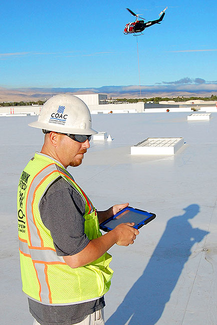 Cooper Oates Air Conditioning Foreman On Amazon Roof with Ipad